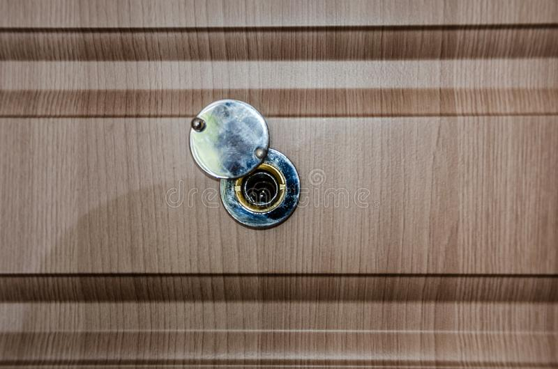 Peephole on the door. Close-up. Side view stock photography