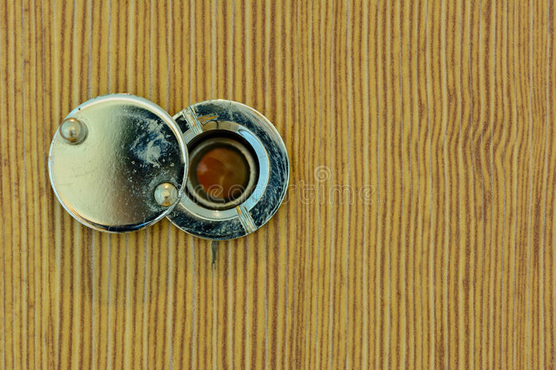 Peephole. On the door in hotel stock photos