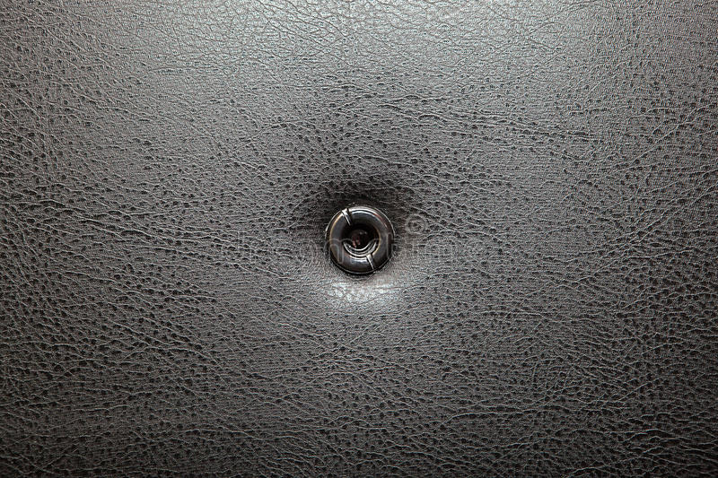 Peephole. In the door with leather upholstery royalty free stock photo