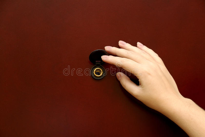 The peephole with hand. Close up shot royalty free stock image