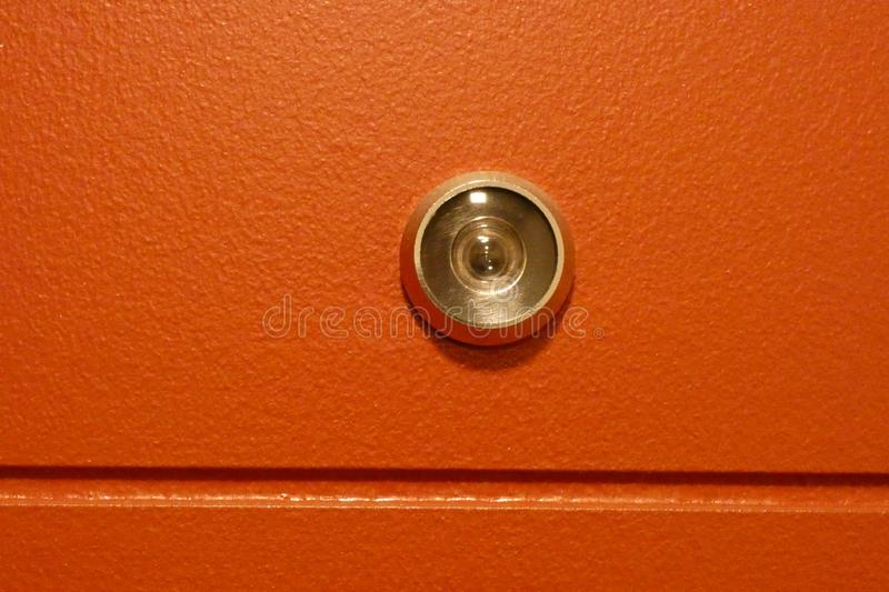 Peephole. A peephole on a red door royalty free stock image