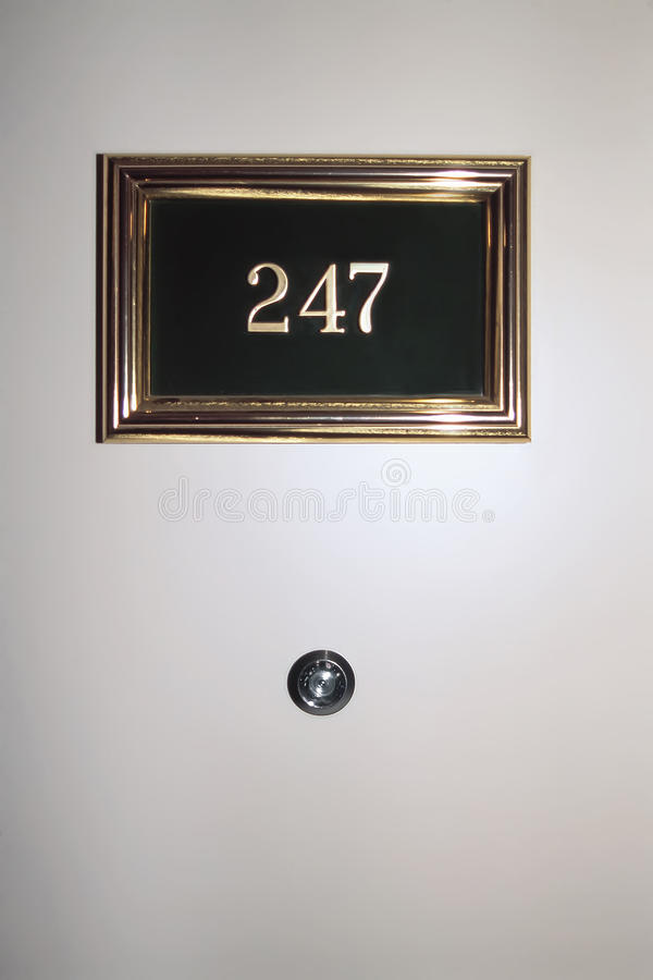 Peephole. Room number and peephole on the front door stock photos