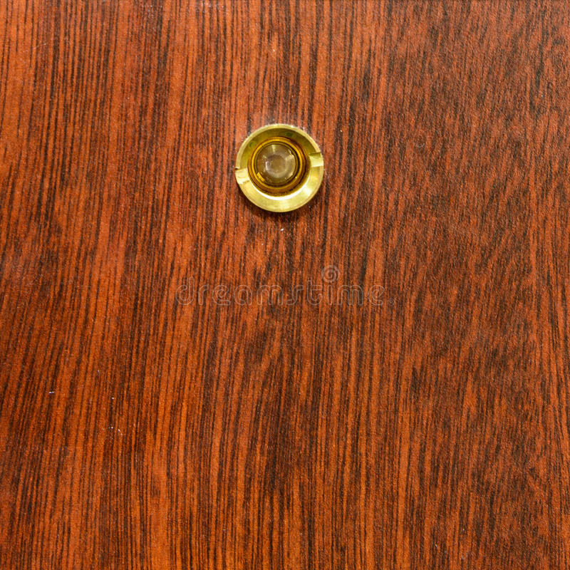 Peephole. On a wood door royalty free stock images