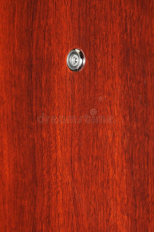Peephole on wooden door. Judas hole spyhole stock photography