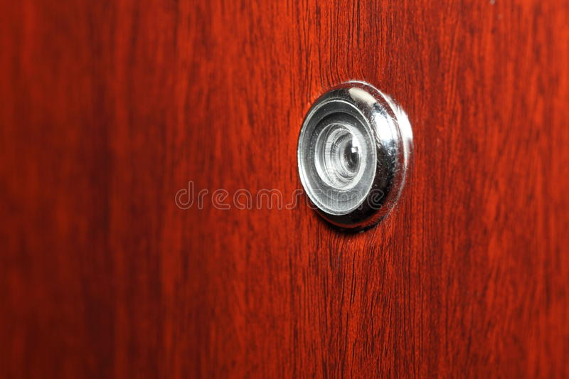 Peephole on wooden door. Judas hole spyhole stock photos
