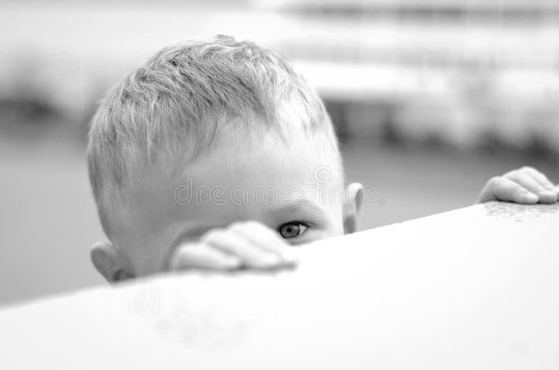 Peeping boy royalty free stock photography