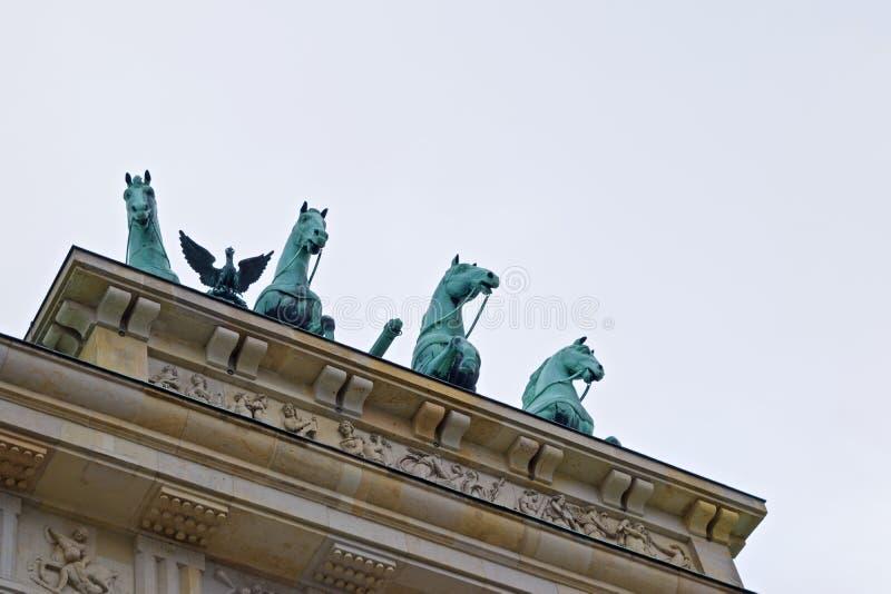 Peeping horses Brandenburger Gate Berlin stock image