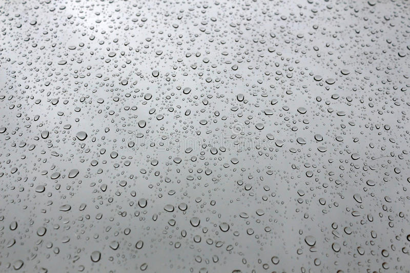Pefect water drops in a window royalty free stock photo