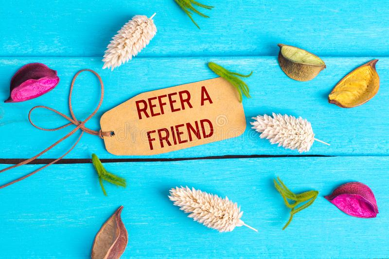 refer a friend text on paper tag stock photography