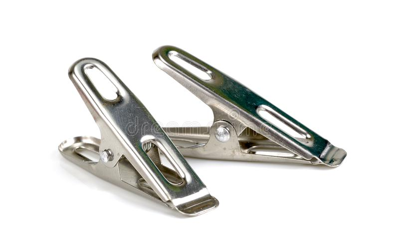 Peg steel, metal clothespin isolated on white background royalty free stock image