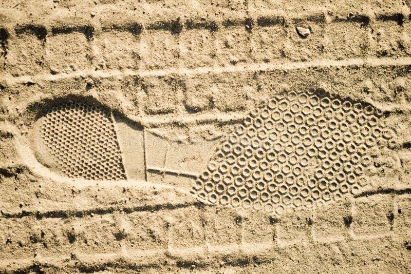Pegada em uma areia fotos de stock