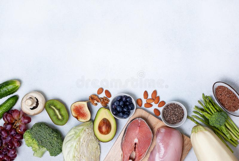 Pegan diet products. Trendy pegan diet. pegan diet products : meat, fish, cereals, vegetables, nuts and berries. view from above royalty free stock images