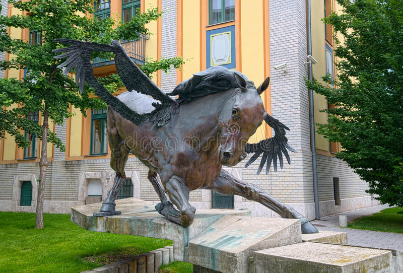 Pegasus statue in Budapest, Hungary. BUDAPEST, HUNGARY - JUNE 10, 2016: Shaman bronze statue, also called as Pegasus, created by Veres Kalman for EXPO-2000 stock images