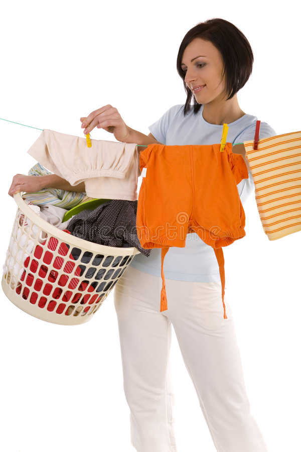 Pegging clothes on line stock photos
