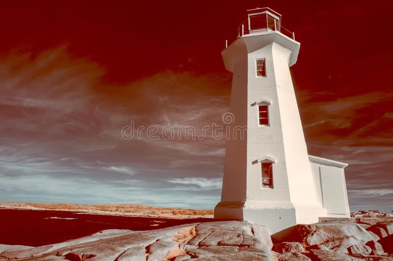 Peggy Cove Lighthouse, Nova Scotia, Canada in infrared stock image