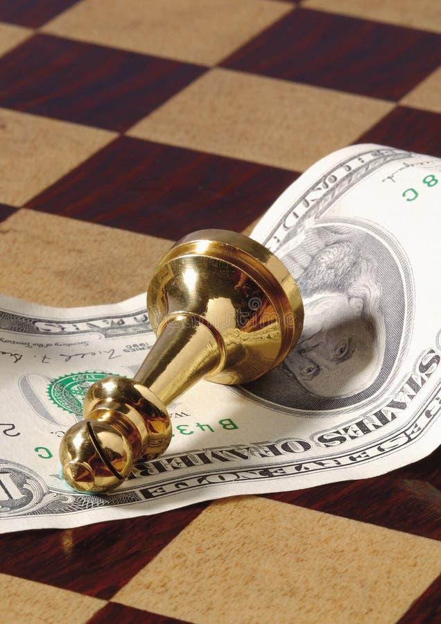 pegno dorato di scacchi sull'americano fotografie stock libere da diritti