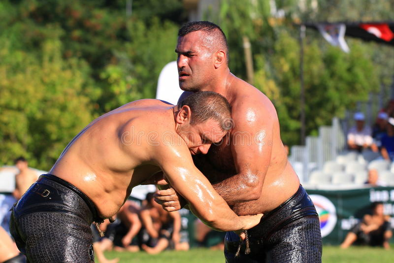 Pehlivan aims to control his opponent by putting his arm through the latter's kisbet. ISTANBUL - AUGUST 24: Unidentified wrestlers in the Sile Annual Oil royalty free stock photography