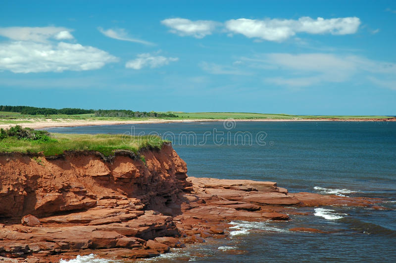 PEI Coast. Ocean view of red rocks on the PEI coast of Canada stock photography