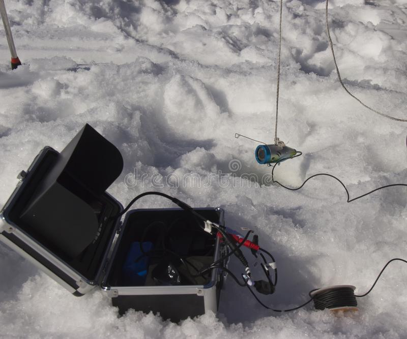 Peiler voor visserij in de winter stock foto's