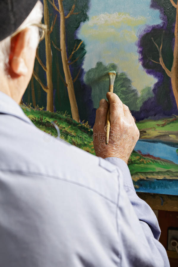 Peintre au travail photo stock