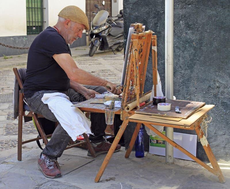 Peintre de rue travaillant aux rues en Séville, Espagne photo libre de droits