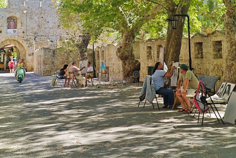 Peintres ville d'île de Rhodes à la vieille photos stock