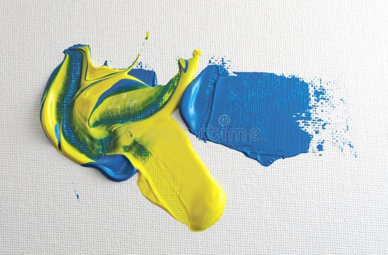 Peinture acrylique bleue et jaune images stock