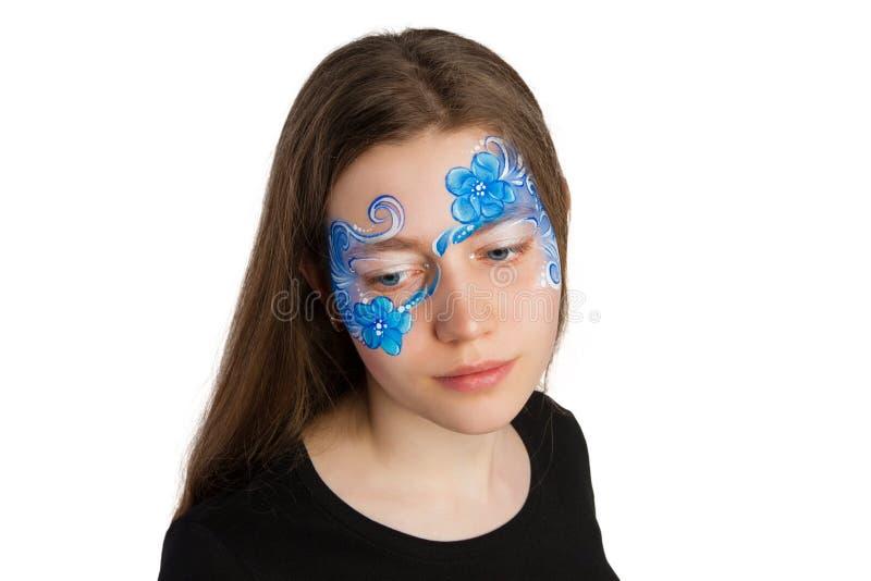 Peinture bleue de visage d'ornement floral photos stock