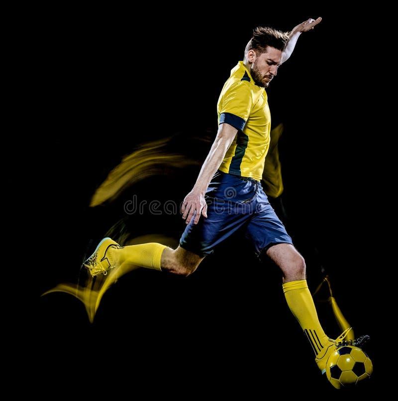 Peinture caucasienne de lumi?re de fond de noir d'homme de footballeur photo stock