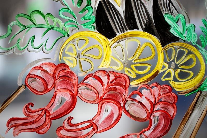 Peinture colorée sur un verre photo stock