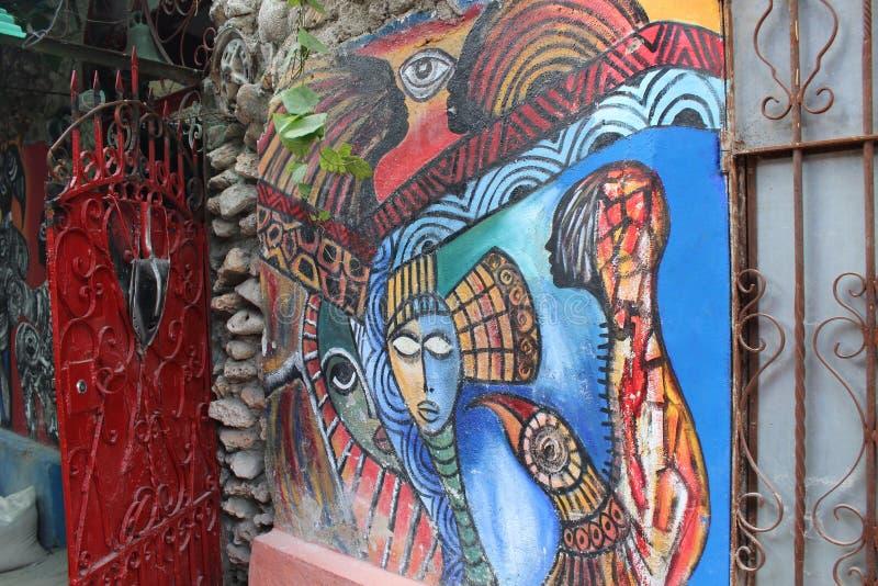 Peinture d'Africain-Cubain sur le mur, créé par un artiste local Callejon de Hamel, La Havane image libre de droits