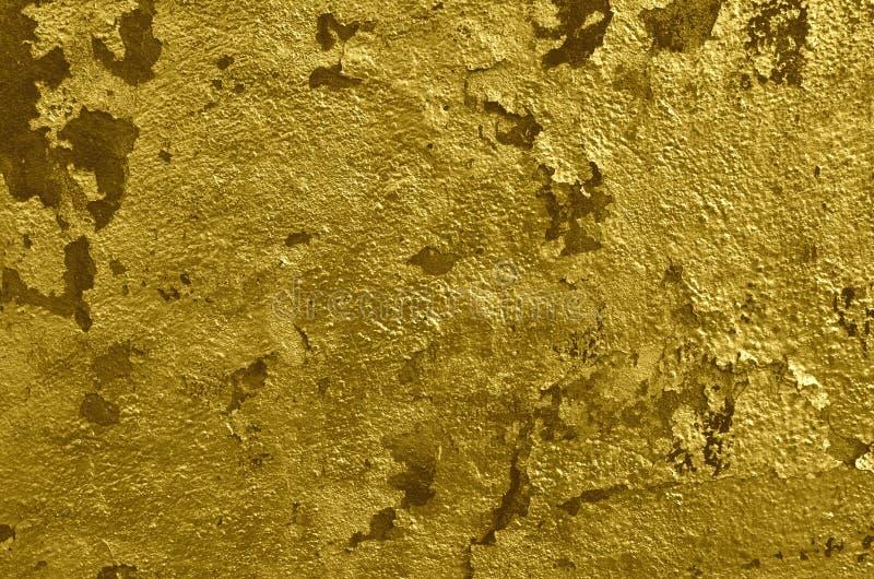 Peinture de ?pluchage brillante de couleur d'or photos stock