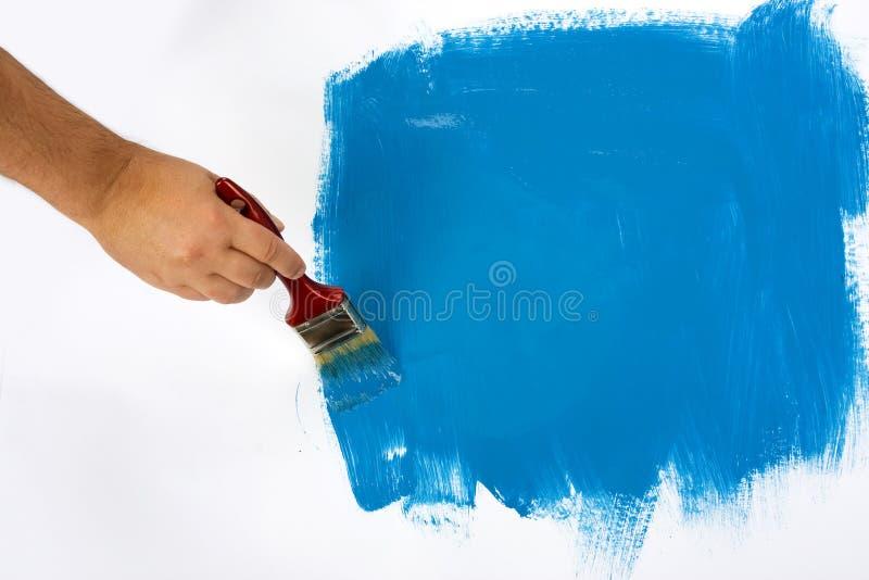 Peinture de main dans le bleu images libres de droits