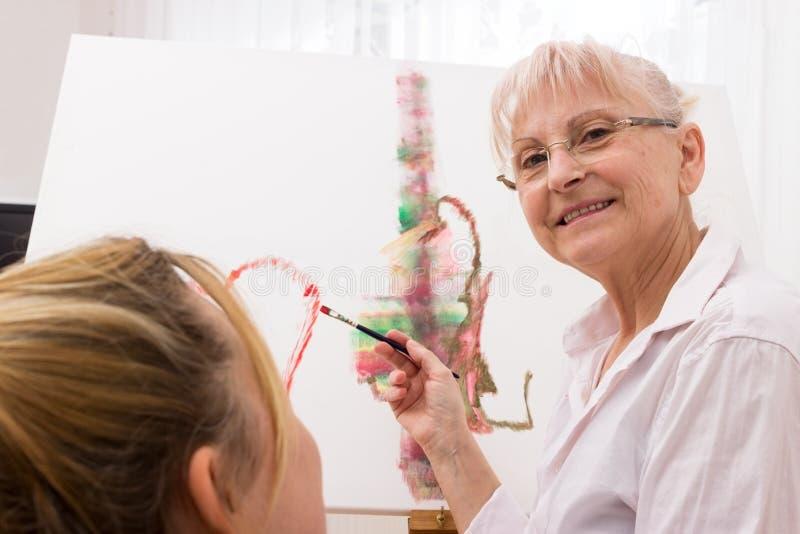 Peinture de moment de retraité photos stock