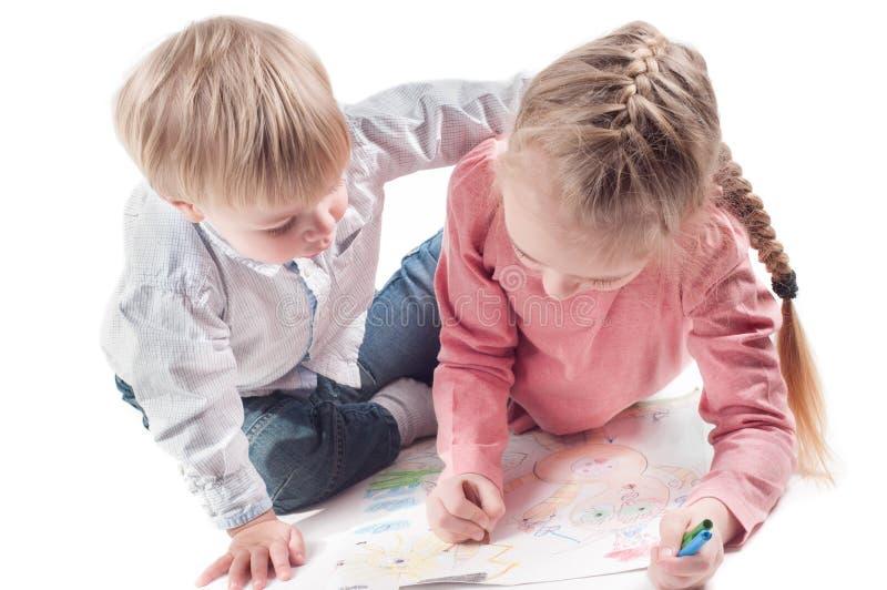 Peinture de petite fille et de garçon photos stock