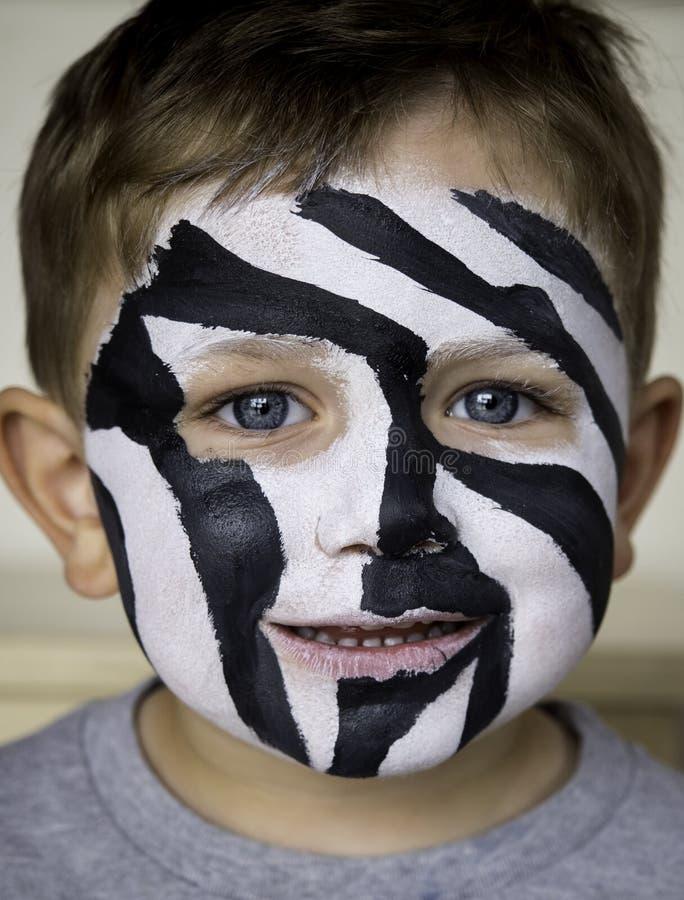 Peinture de visage de zèbre photographie stock