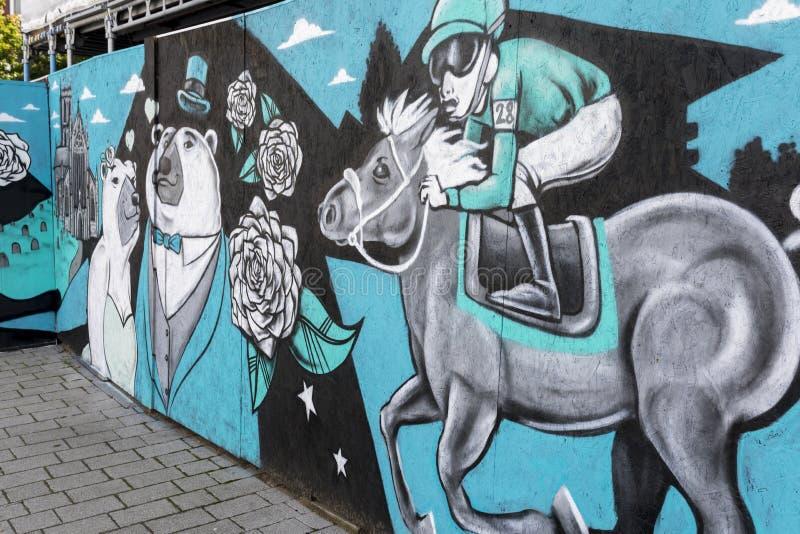 Peinture murale d'art de rue de Doncaster, St Leger, course de chevaux, comique, cheval image libre de droits