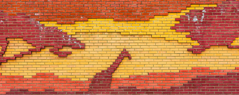 peinture murale de ` de girafe de ` Le concept de peinture de brique photographie stock