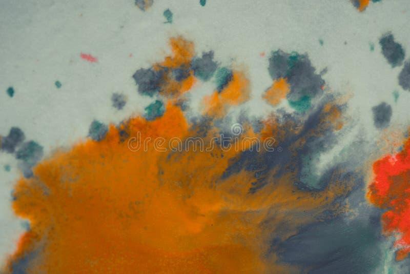 Peinture orange et bleu-foncé lumineuse de débordement sur le papier photos stock