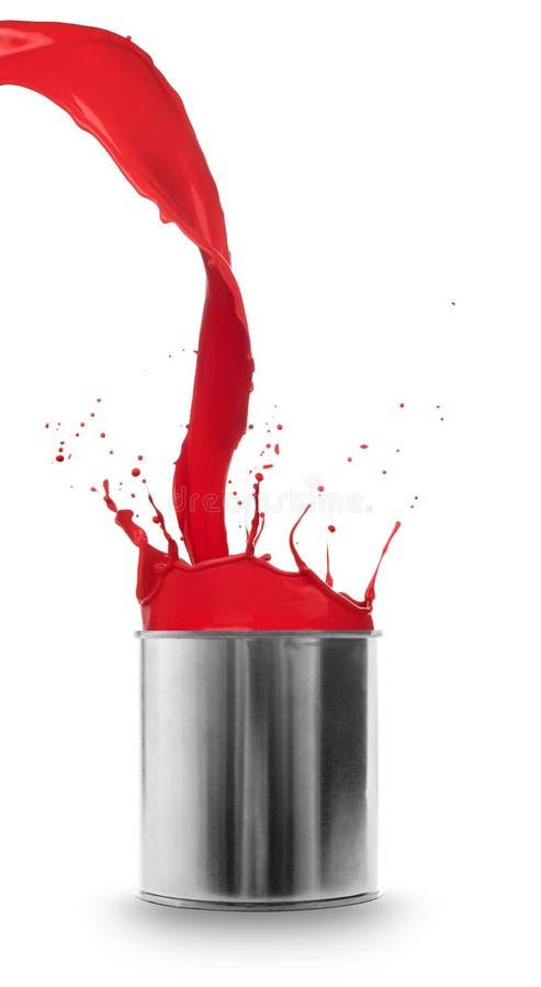 Peinture rouge éclaboussant hors du bidon images libres de droits