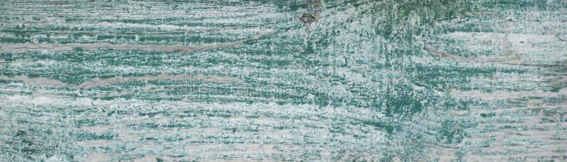 Peinture superficielle par les agents par blanc usé avec le vert dessous photographie stock libre de droits