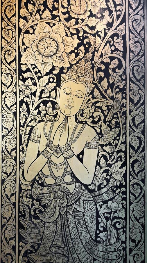 Peinture thaïlandaise de style sur la porte du temple de Wat Chedi Laung, Chian photographie stock