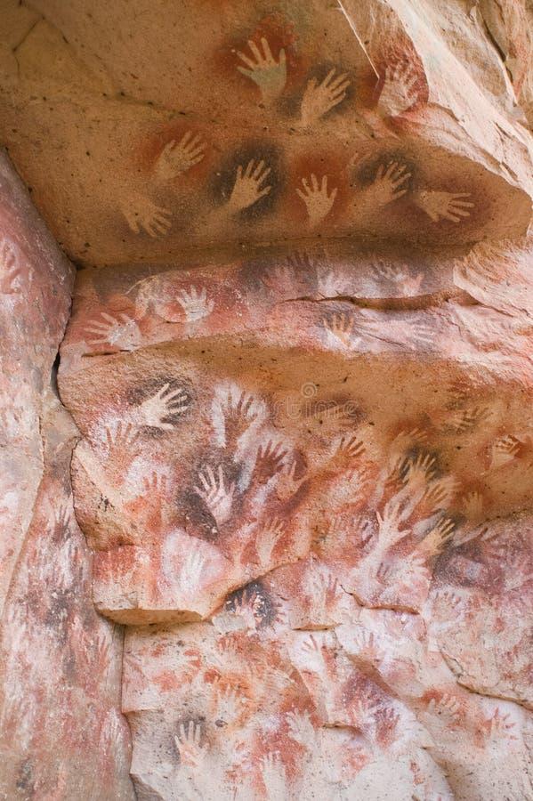 Peintures de caverne antiques dans le Patagonia photos stock
