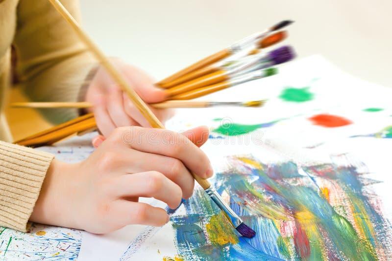 Peintures et brosses photos stock
