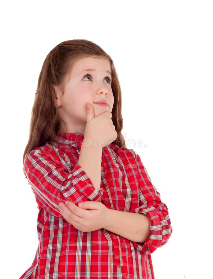 Peinzend meisje met rood plaidoverhemd royalty-vrije stock afbeeldingen