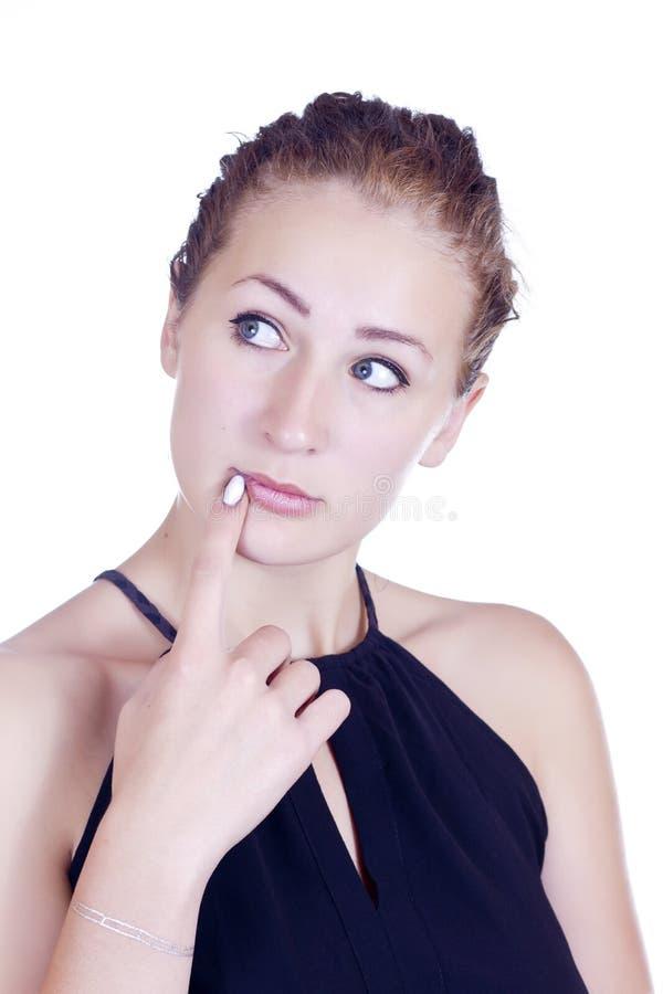 Peinzende jonge vrouw die een vraag stellen aan zich stock afbeeldingen