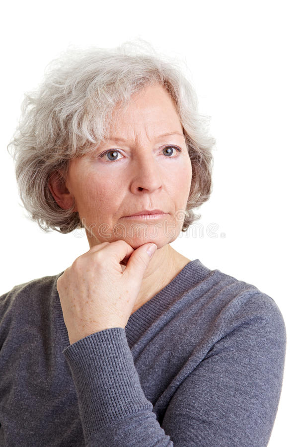 Peinzende oude vrouw royalty-vrije stock afbeelding