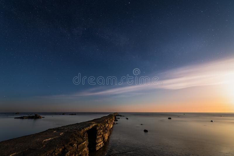 The peir in Seby lit by the ascending moon stock photography
