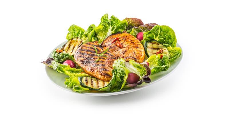 Peito de frango da grade do peito de frango com o abobrinha da salada da alface foto de stock