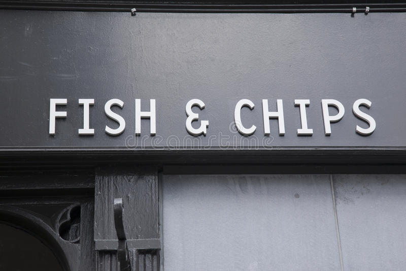 Peixes e Chip Sign imagem de stock royalty free